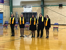 5 students with sashes