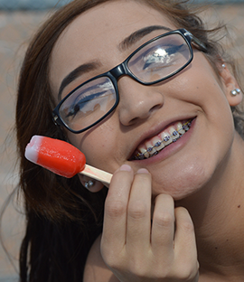 Smiling female student poses with a popsicle