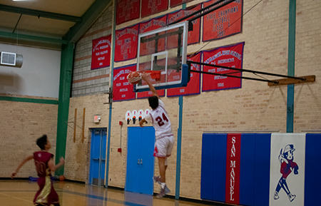Caleb Quintero '20 slam dunks the basket. Picture: Aime Diaz '22