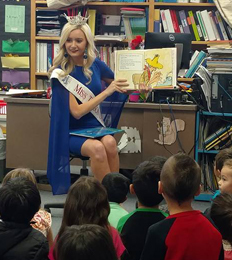 Pageant winner reads to students