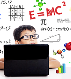 kid using laptop with equations on whiteboard