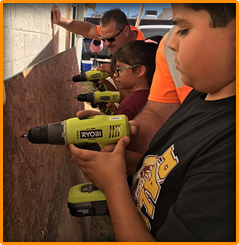 students working with power tools
