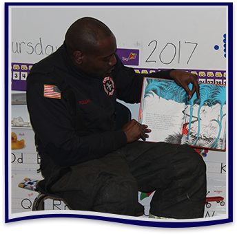 Police officer reads a book to students