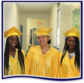 Three happy high school girls in yellow cap and gowns at graduation