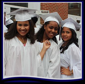 Three female graduates pose together
