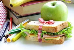 Sandwich, apple, banana, markers, books