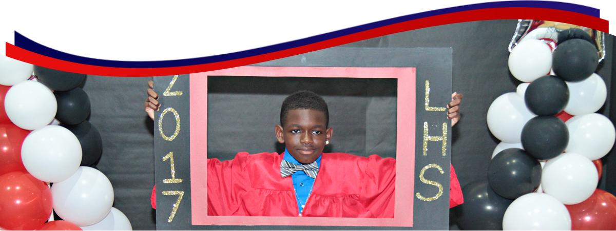 student holding red frame 2017 LHS