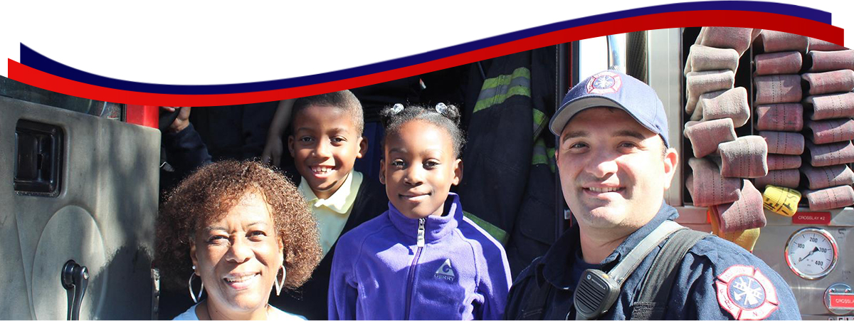 6-East Orange teacher and students with fireman