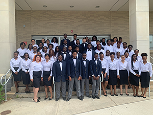 East Orange Campus Chamber Singers pose together outside