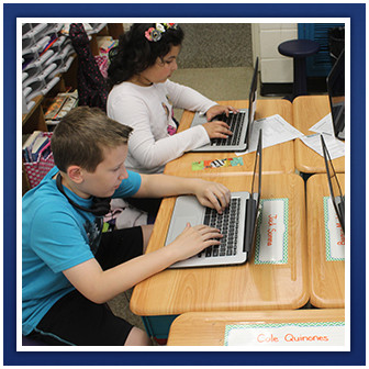 Students use laptops at their desks