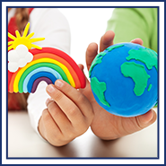Children's hands hold clay rainbow and globe figures