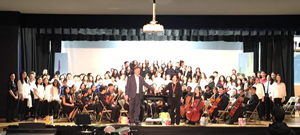Orchestra standing on stage