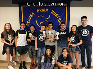 Click for more photos. Students pose together in front of a Bergen Brain Busters sign.