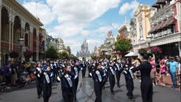 The Paramus High School Spartan marching band performs on Main Street in Magic Kingdom
