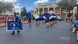 The Paramus High School Spartan marching band walks down Main Street in the Magic Kingdom