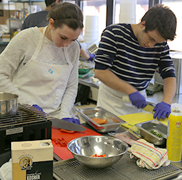 Students work in a kitchen
