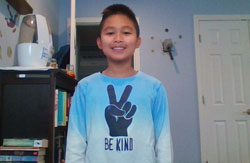 Student wearing Be Kind tee shirt