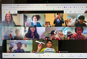Teachers and students showing off straw rockets during virtual meeting