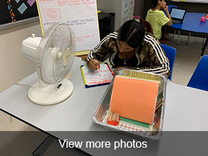 view more photos of students studying science