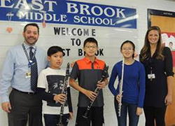 East Brook band members pose together with staff