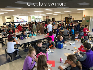 Students eat lunch together in the cafeteria