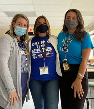 Three teachers wearing blue shirts during Week of Respect