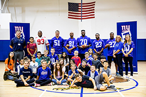 New York Giants pose with middle school students