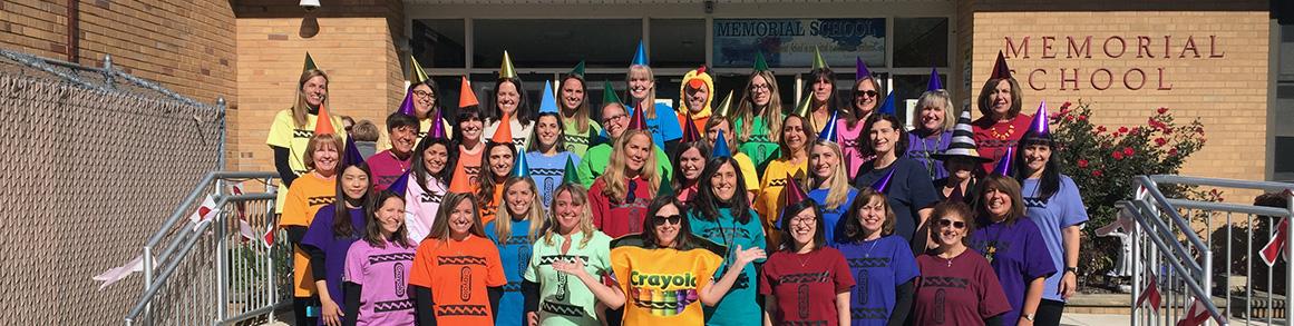 1- Memorial teachers dressed in costumes in front of school