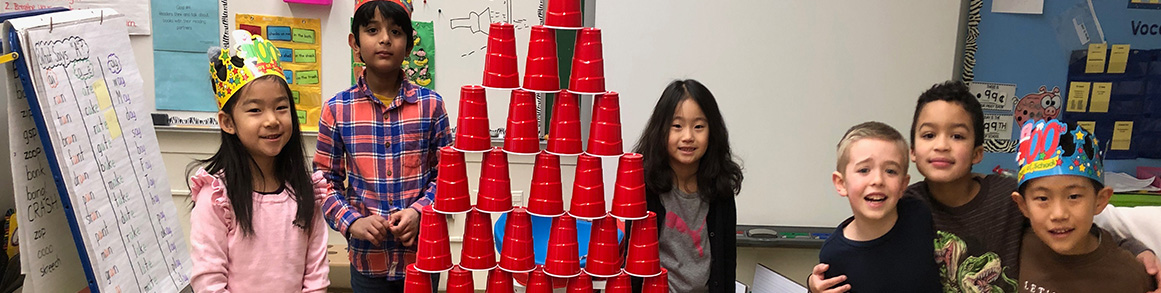3-Group of elementary students with their cup stacking project