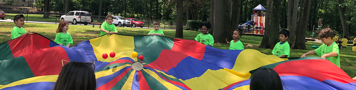 Memorial students having fun with a parachute on field day