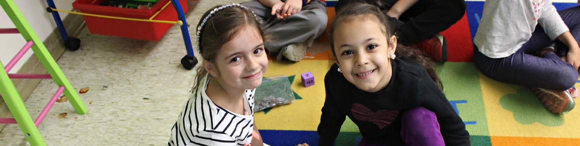 two girls enjoying class