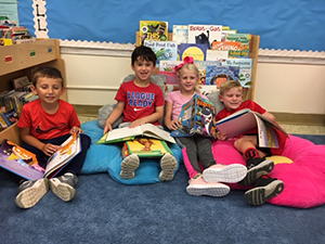 Students reading with pillows
