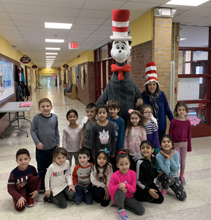 Students posing with The Cat In The Hat character