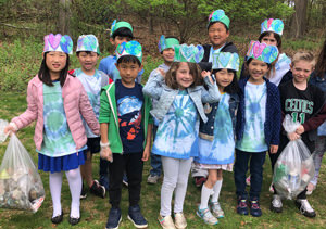 Group of students wearing I love earth hats