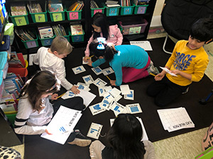 students playing a place value game