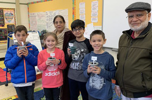 Students standing with two visiting grandparents