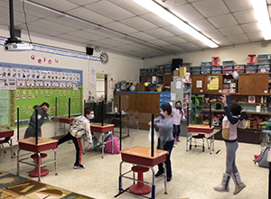 first graders celebrating snow in classroom
