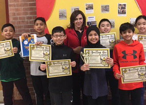 The principal with spelling bee participants