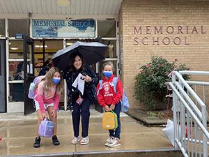 Principal O'Boyle greeting students back to school