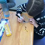 Student uses a ruler to make and measure angles