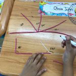 Student practices making and measuring angles using Bendaroos and markers