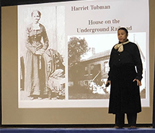 An adult presents a presentation on Harriet Tubman