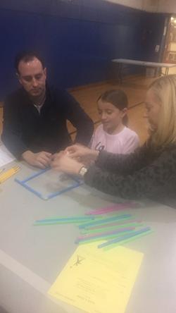 Parents help a student design a structure