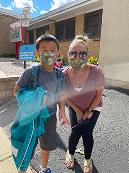 Teacher and student in matching masks