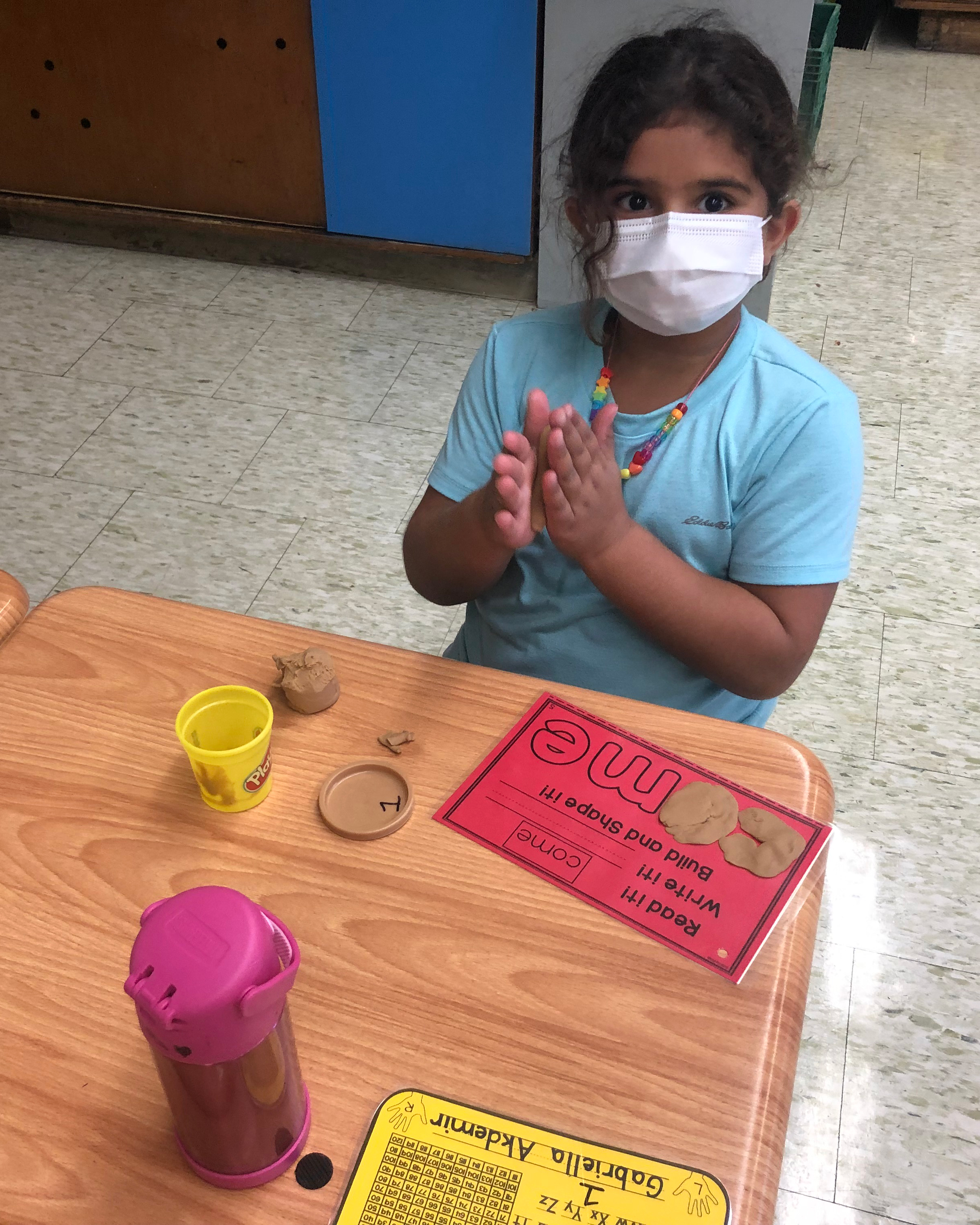 girl playing with playdoh