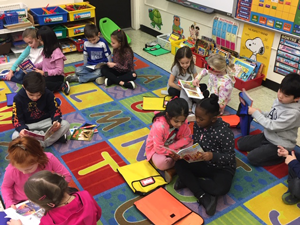 students in library reading together