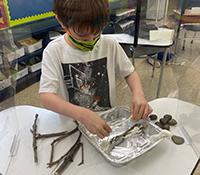child working on beaver dam