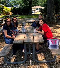 teachers eating under the trees in the ELC