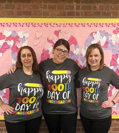 Teachers wearing 100 days of school t-shirts