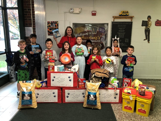 students with donations for the animal shelter